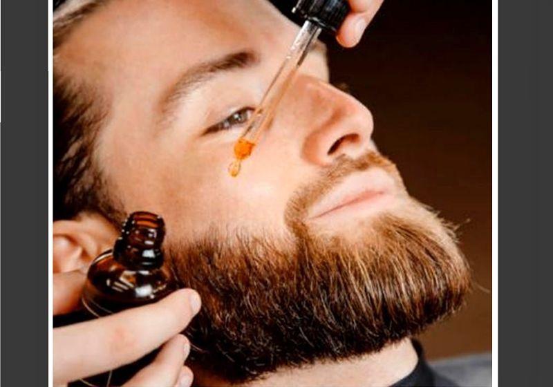 Imagem de modelo masculino aplicando óleo na barba